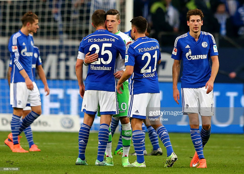 Players of Schalke comfort <a gi-track='captionPersonalityLinkClicked' href=/galleries/search?phrase=Julian+Draxler&family=editorial&specificpeople=7184479 ng-click='$event.stopPropagation()'>Julian Draxler</a> (C) of Wolfsburg during the Bundesliga match between FC Schalke 04 and VfL Wolfsburg at Veltins-Arena on February 6, 2016 in Gelsenkirchen, Germany.