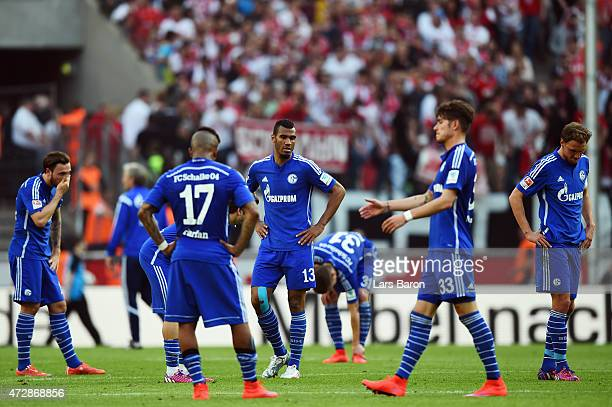 Players of Schalke react after the Bundesliga match between 1 FC Koeln and FC Schalke 04 at RheinEnergieStadion on May 10 2015 in Cologne Germany