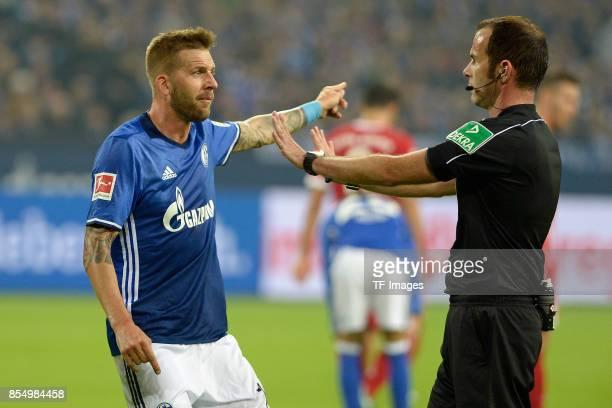 Players of Schalke speak with Referee Marco Fritz during the Bundesliga match between FC Schalke 04 and FC Bayern Muenchen at VeltinsArena on...