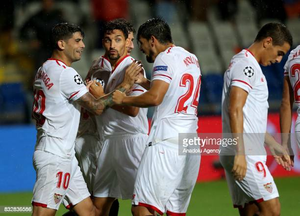 Players of Sevilla FC celebrate after scoring a goal during the UEFA Champions League playoff match between Medipol Basaksehir and Sevilla FC at...