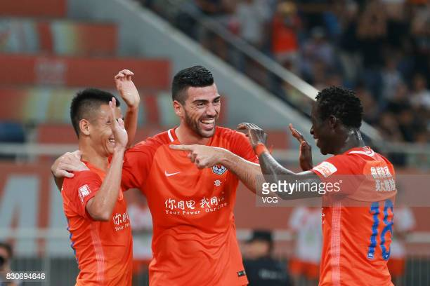Players of Shandong Luneng celebrate a point during the 22nd round match of 2017 Chinese Football Association Super League between Shanghai Shenhua...