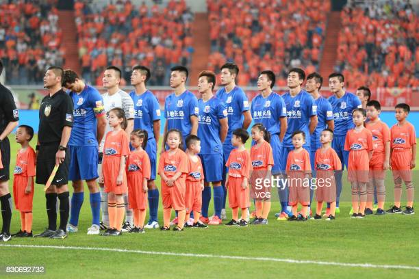 Players of Shanghai Shenhua line up prior to the 22nd round match of 2017 Chinese Football Association Super League between Shanghai Shenhua and...