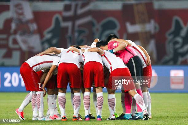 Players of Shanghai SIPG encourage during the 21st round match of 2017 China Super League between Hebei China Fortune FC and Shanghai SIPG FC at...