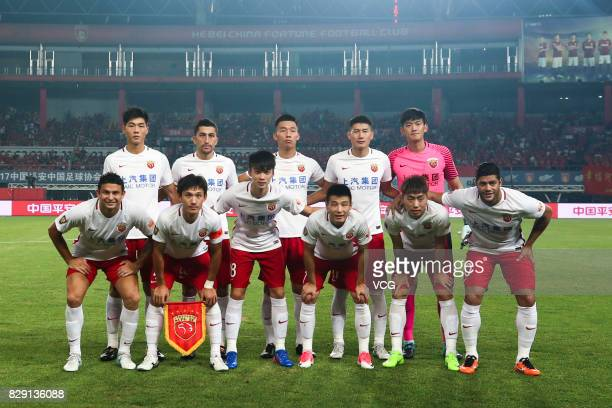 Players of Shanghai SIPG line up prior to the 21st round match of 2017 China Super League between Hebei China Fortune FC and Shanghai SIPG FC at...