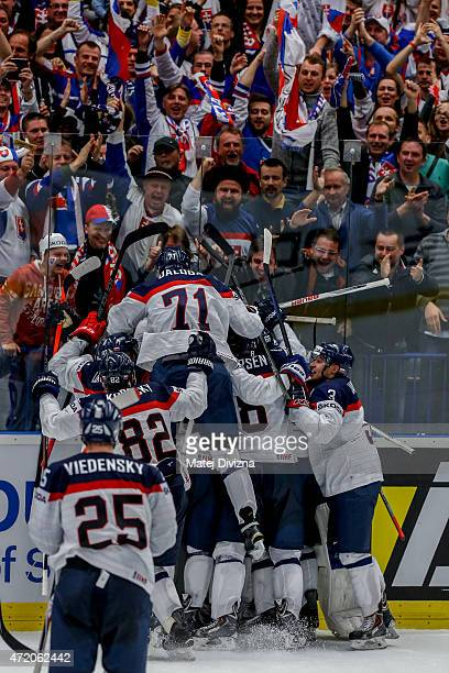 Players of Slovakia celebrate after the IIHF World Championship group B match between Belarus and Slovakia at CEZ Arena on May 3 2015 in Ostrava...