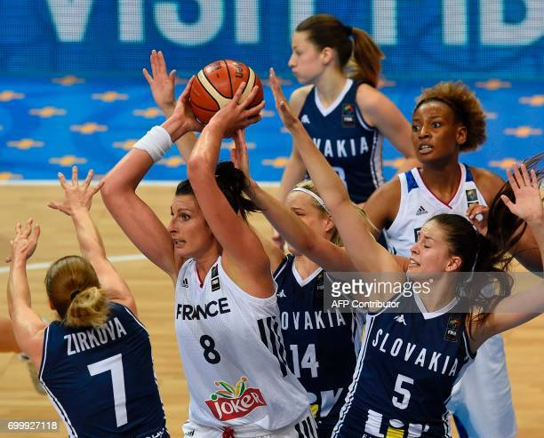 Players of Slovakia try to block Helena Ciak of France during the FIBA EuroBasket women's quarterfinal match between France v Slovakia on June 22...