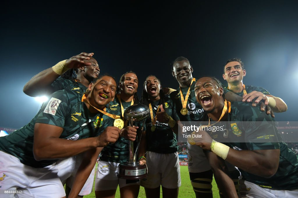 Players of South Africa pose for photos with the trophy after winning the Cup Final match between South Africa and New Zealand on Day Three of the Emirates Dubai Rugby Sevens - HSBC Sevens World Series at The Sevens Stadium on December 2, 2017 in Dubai, United Arab Emirates.