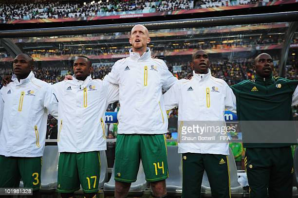 Players of South Africa sing the National anthem prior to the 2010 FIFA World Cup South Africa Group A match between South Africa and Mexico at...