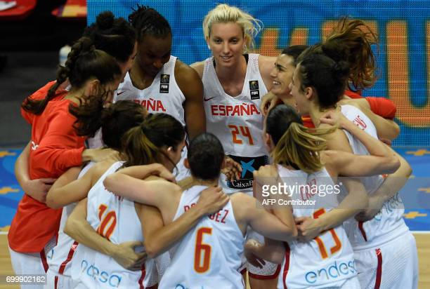 Players of Spain celebrate their victory after the FIBA EuroBasket 2017 women's quarterfinal match between Spain and Latvia on June 22 2017 in Prague...