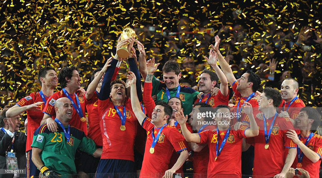 Players of Spain celebrate with the FIFA World Cup trophy after winning the 2010 World Cup football final by defeating The Netherlands during extra time at Soccer City stadium in Soweto, suburban Johannesburg on July 11, 2010. NO