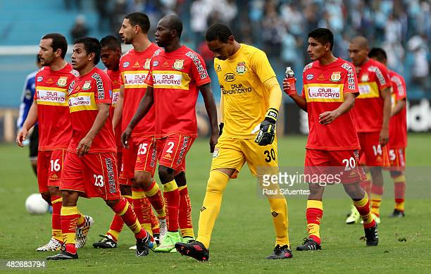 Players of Sport Huancayo leave the field at the end of the first half of a match between Sporting Cristal and Sport Huancayo as part of 14th round...