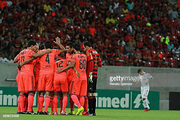 Players of Sport Recife enter into the field before a match between Sport Recife and Internacional as part of Brasileirao Series A 2014 at Arena...