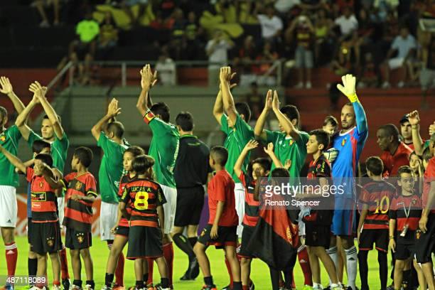 Players of Sport Recife enter the field before a match between Sport Recife and Chapecoense as part of Brasileirao Series A 2014 at Ilha do Retiro...