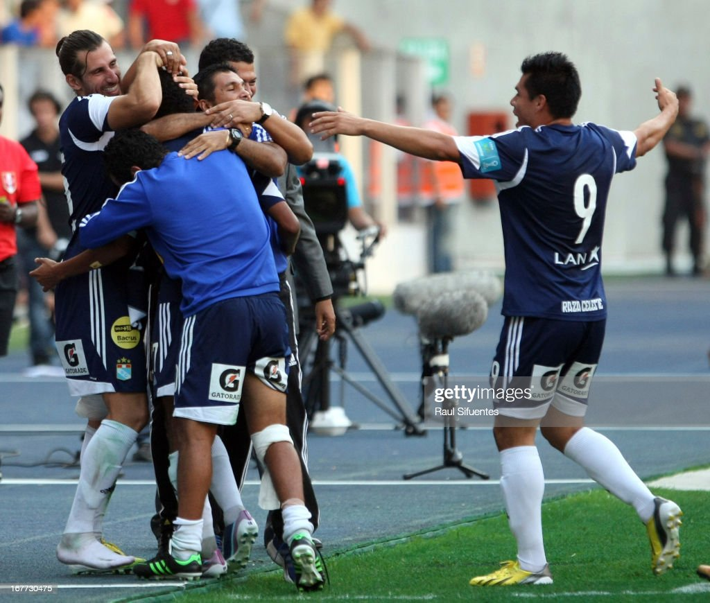 Players of Sporting Cristal celebrate a goal against Universitario during a match between Sporting Cristal and Universitario as part of the Torneo Descentralizado 2013 at the National Stadium on April 28, 2013 in Lima, Peru