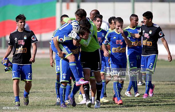 Players of Sporting Cristal celebrate a victory at the end of a match between San Simon and Sporting Cristal as part of eighth round of Torneo...