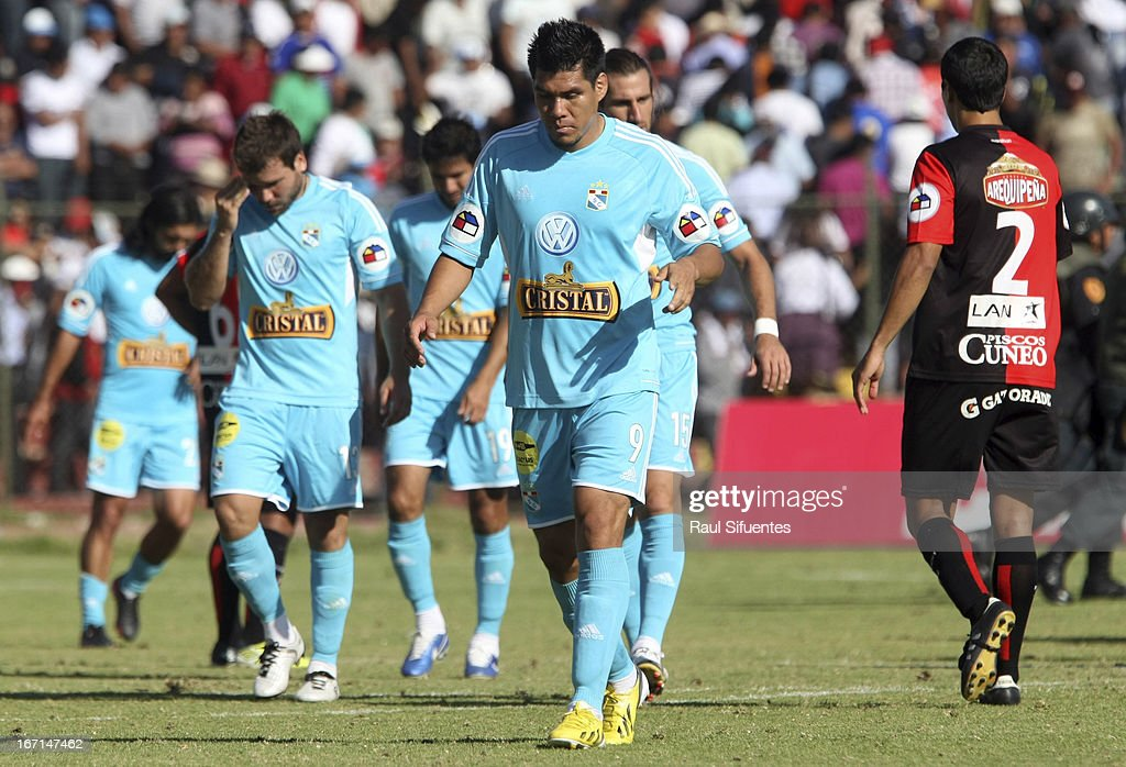 Players of Sporting Cristal react after a match between Sporting Cristal and Melgar FC as part of the Torneo Descentralizado 2013 at the Mariano Melgar Stadium on April 21, 2013 in Arequipa, Peru.