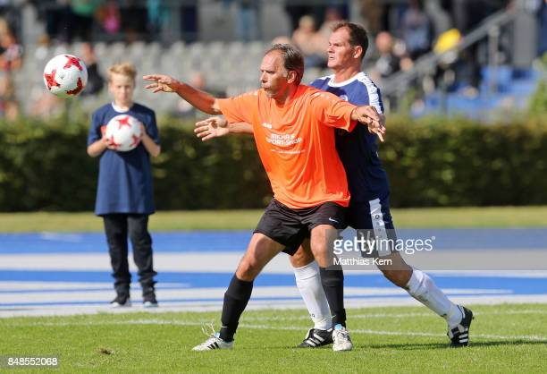 Players of SpVg Blau Weiss 1890 and SG Mittelmosel Leiwen battle for the ball during the DFB over 40 and 50 cup at Amateurstadion on September 17...