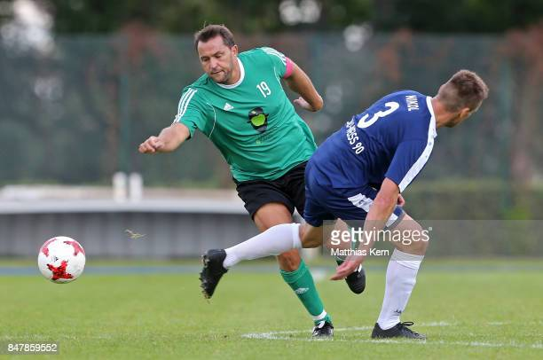 Players of SpVg Blau Weiss 1890 and SV Eintracht 1912 Verlautenheide battle for the ball during the DFB over 40 and 50 cup at Amateurstadion on...
