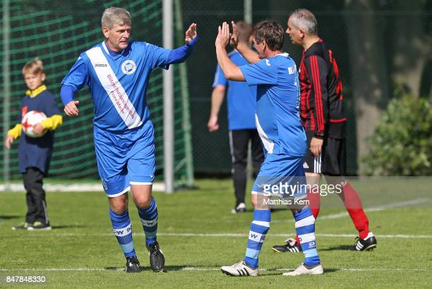 Players of SpVg Blau Weiss 1890 jubilate after scoring a goal during the match between SpVg Blau Weiss 1890 and TuS Frisia Goldenstedt during the DFB...