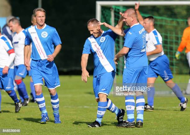 Players of SpVg Blau Weiss 1890 jubilate after scoring a goal during the match between SpVg Blau Weiss 1890 and TV Askania Bernburg during the DFB...