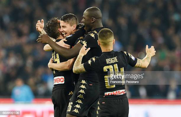 Players of SSC Napoli celebrate after Dries Mertens scored the 10 goal during the Serie A match between SSC Napoli and Udinese Calcio at Stadio San...