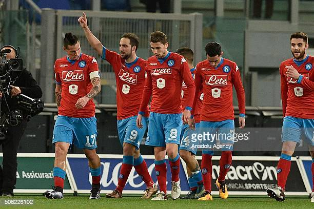 Players of SSC Napoli celebrate after scoring a goal during the Serie A match between SS Lazio and SSC Napoli at Stadio Olimpico on February 3 2016...