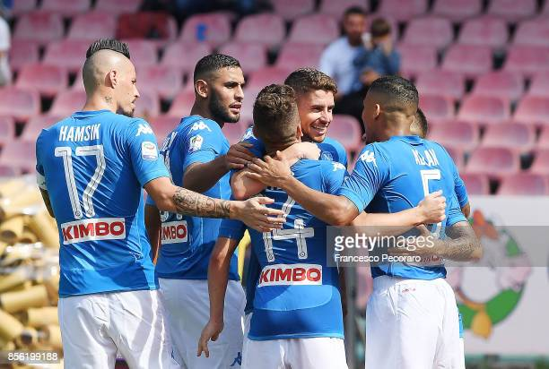 Players of SSC Napoli celebrate the 20 goal scored by Dries Mertens during the Serie A match between SSC Napoli and Cagliari Calcio at Stadio San...