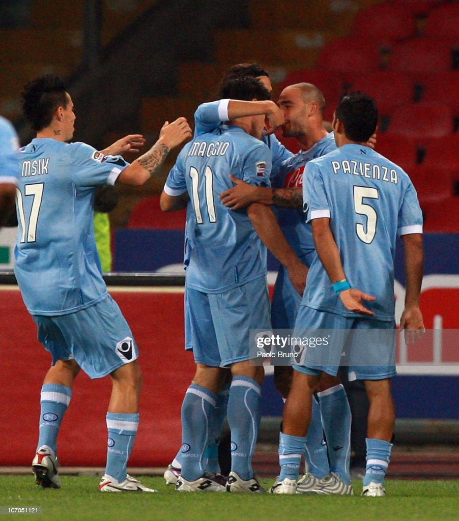Players of SSC Napoli celebrate the goal scored by <a gi-track='captionPersonalityLinkClicked' href=/galleries/search?phrase=Christian+Maggio&family=editorial&specificpeople=2131601 ng-click='$event.stopPropagation()'>Christian Maggio</a> during the Serie A match between SSC Napoli and Bologna FC at Stadio San Paolo on November 21, 2010 in Naples, Italy.