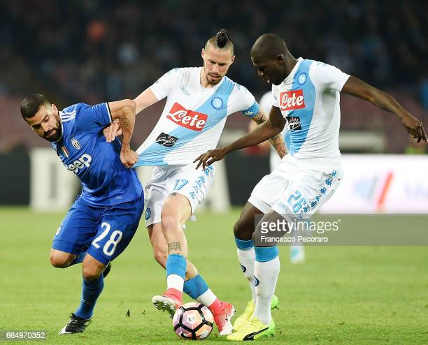 Players of SSC Napoli Marek Hamsik and Kalidou Koulibaly vies with Juventus FC player Tomas Rincon during the TIM Cup match between SSC Napoli and...