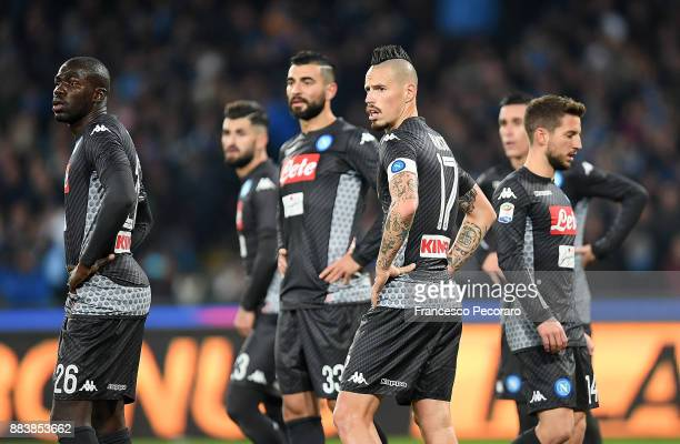 Players of SSC Napoli Marek Hamsik Kalidou Koulibaly Raul Albiol Dries Mertens stand disappointed during the Serie A match between SSC Napoli and...