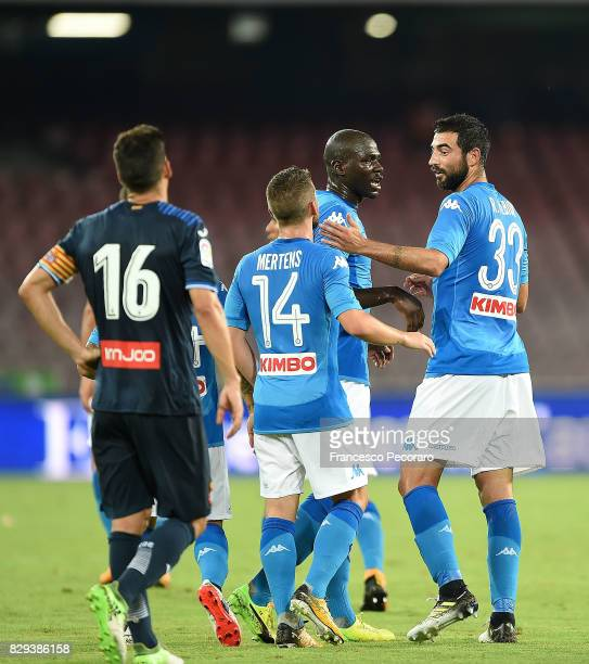 Players of SSC Napoli Raul Albiol and Dries Mertens celebrate after Raul Albiol scored the 20 goal beside the disappointment of Javi Lopez player of...