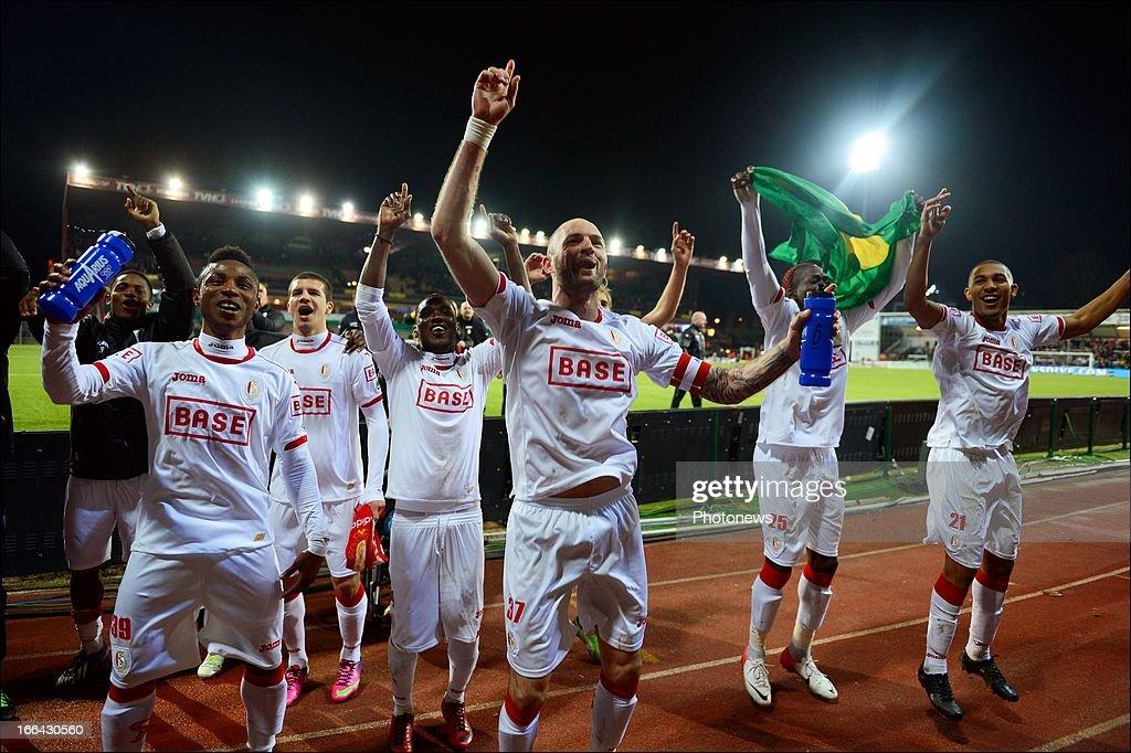 Players of Standard celebrate after the Jupiler League match playoff 1 between Zulte Waregem and Standard de Liege on April 12 2013 in Waregem Belgium