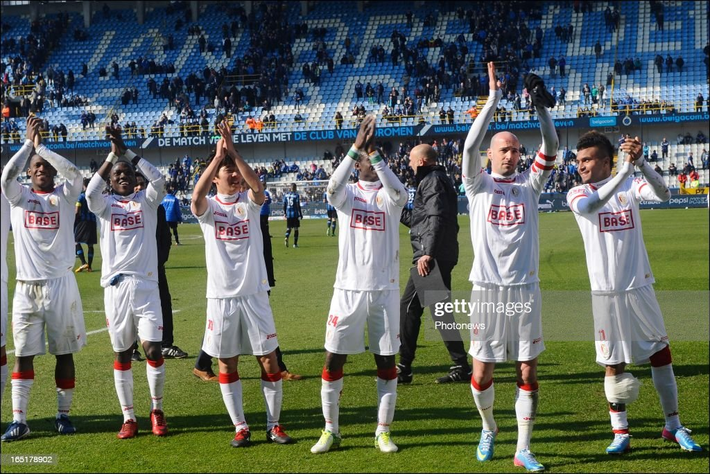 Players of Standard celebrate victory after the Jupiler League match between Club Brugge and Standard de Liege , in the Jan Breydel Stadium on April 01, 2013 in Brugge, Belgium.