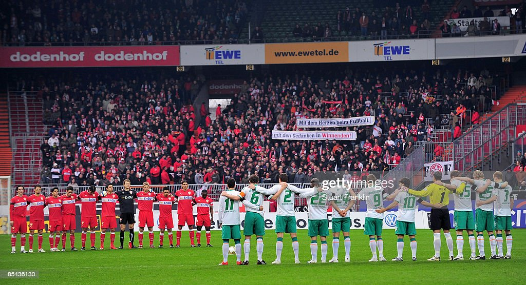 Players of Stuttgart and of Bremen observe the one minute silence in remembrance of the 16 people shot by a gunman earlier in the week during the Bundesliga match between Werder Bremen and VfB Stuttgart at the Weser Stadium on March 15, 2009 in Bremen, Germany.
