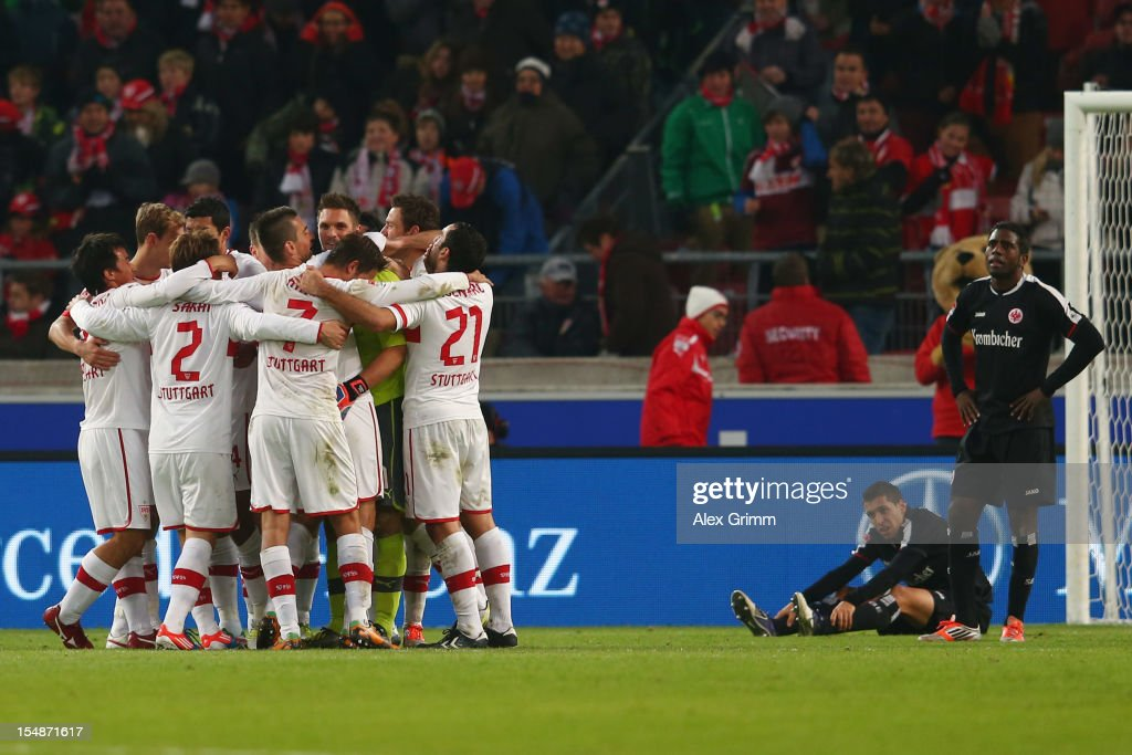 Players of Stuttgart celebrate as <a gi-track='captionPersonalityLinkClicked' href=/galleries/search?phrase=Karim+Matmour&family=editorial&specificpeople=741965 ng-click='$event.stopPropagation()'>Karim Matmour</a> (bottom) and <a gi-track='captionPersonalityLinkClicked' href=/galleries/search?phrase=Olivier+Occean&family=editorial&specificpeople=747391 ng-click='$event.stopPropagation()'>Olivier Occean</a> (R) react after the final whistle of the Bundesliga match between VfB Stuttgart and Eintracht Frankfurt at Mercedes-Benz Arena on October 28, 2012 in Stuttgart, Germany.