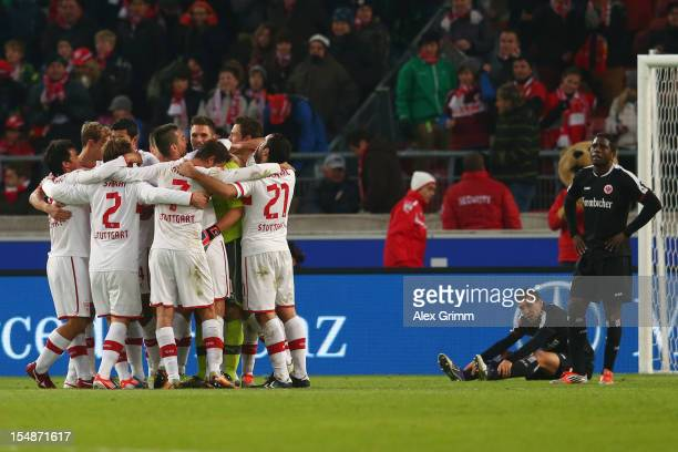 Players of Stuttgart celebrate as Karim Matmour and Olivier Occean react after the final whistle of the Bundesliga match between VfB Stuttgart and...