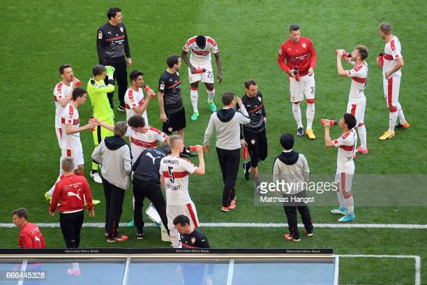 Players of Stuttgart stand together as referee Christian Dingert suspended the match after fans of Karlsruhe threw flares onto the pitch during the...