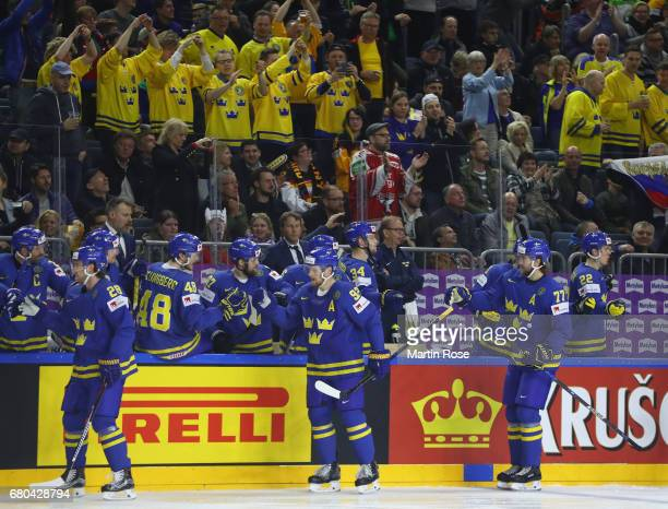 Players of Sweden celebrate the first goal scored by Elias Lindholm during the 2017 IIHF Ice Hockey World Championship game between USA and Sweden at...