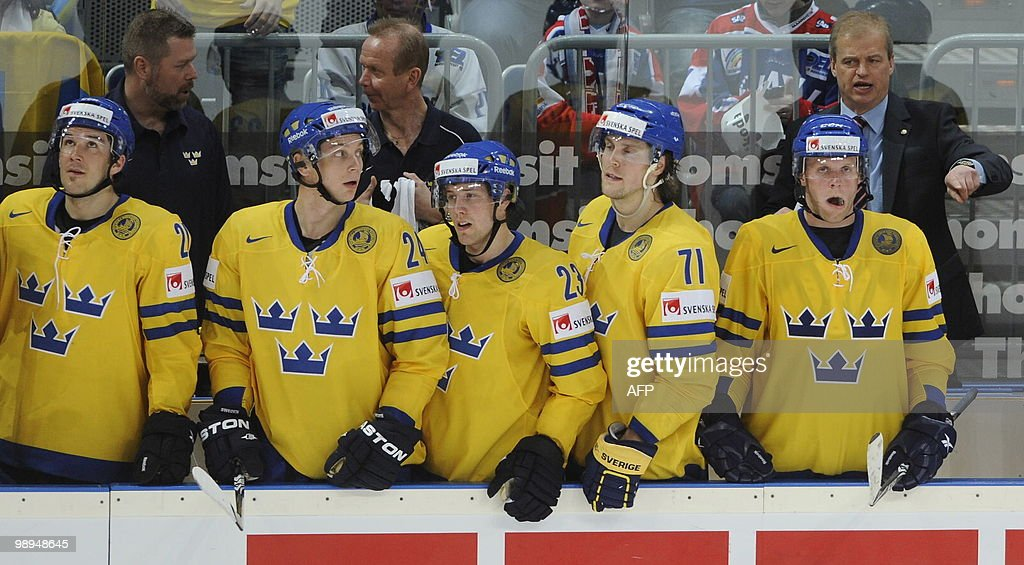 Players of Sweden Jimmie Ericsson Johan Harju Linus Omark Jonas Andersson and coach BengtAke Gustafsson are pictured during the IIHF Ice Hockey World...
