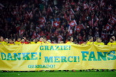 Players of Swiss national team hold a banner reading 'Thanks' in several languages to thank their supporters at the end of the 2014 FIFA World Cup...