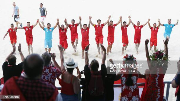 Players of Tahiti celebrate with the fans after winning the FIFA Beach Soccer World Cup Bahamas 2017 quarter final match between Paraguay and Tahiti...