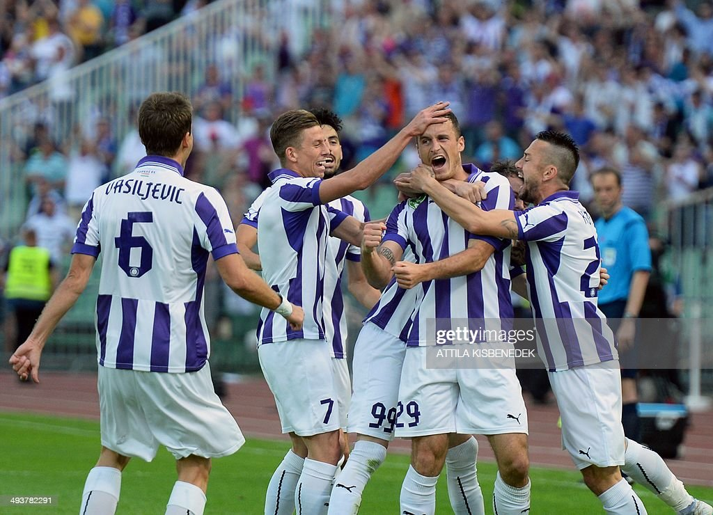 Players of TE Ujpest celebrates scoring during the Hungarian Cup final football match VTK Disosgyor vs TE Ujpest on May 25, 2014 at the Puskas stadium in Budapest.