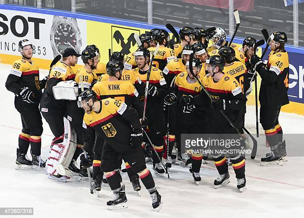 Players of team Germany celebrate after winning against Latvia with the score 21 after the group A preliminary round match Germany vs Latvia at the...
