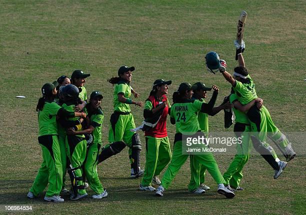 Players of team Pakistan celebrate winning Gold during the Woman's Gold Medal match between Pakistan and Bangladesh at Guanggong Cricket Stadium...