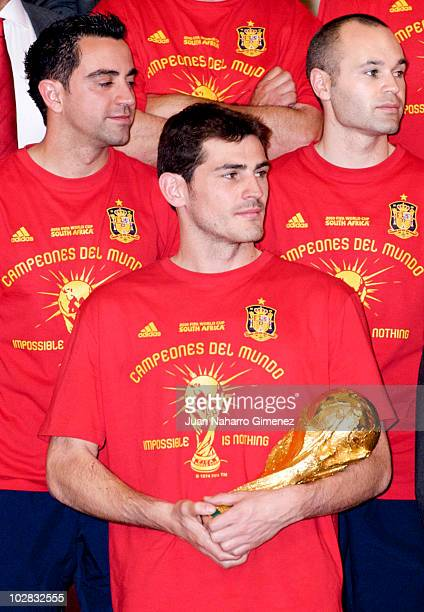 Players of the 2010 FIFA World Cup winning team Spain Xavi Hernandez captain Iker casillas and Andres Iniesta are received by the Spanish royal...