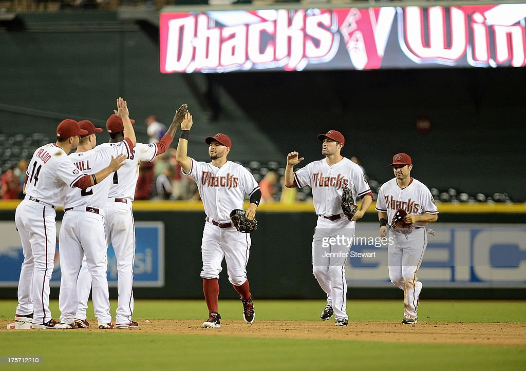 Players of the Arizona Diamondbacks celebrate after defeating the Tampa Bay Rays in the ninth inning at Chase Field on August 6, 2013 in Phoenix, Arizona. The Diamondbacks defeated the Rays 6-1.