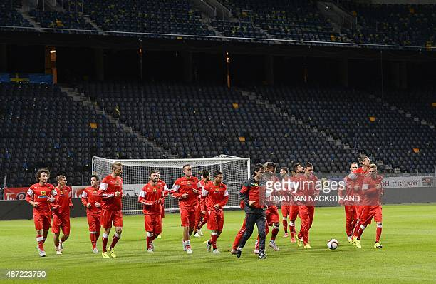 Players of the Austrian national football team take part in a training session at Friends Arena in Solna near Stockholm on September 7 2015 on the...