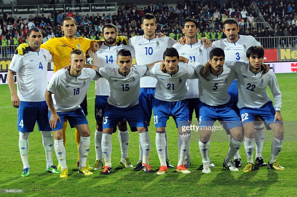 Players of the Azeri national team pose for photographers prior to the FIFA World Cup 2014 qualifying football match between Azerbaijan and Russia in Baku on October 15, 2013.