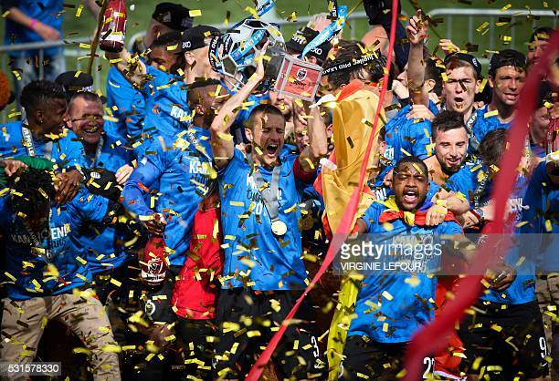 Players of the Belgian football team Club Brugge celebrate after winning for the first time in 11 years the Belgian soccer championship Jupiler Pro...