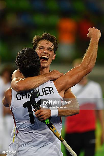Players of the Belgium hockey team Felix Denayer and Cedric Charlier celebrate after their win of the Men's semifinal hockey match Belgium vs...